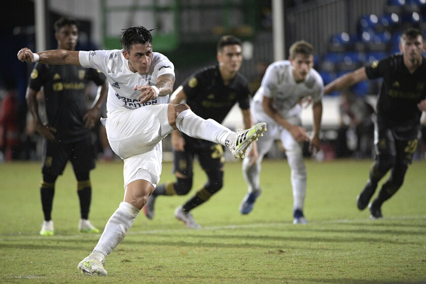 Galaxy forward Cristian Pavon follows through on a penalty kick against the LAFC on July 18, 2020.