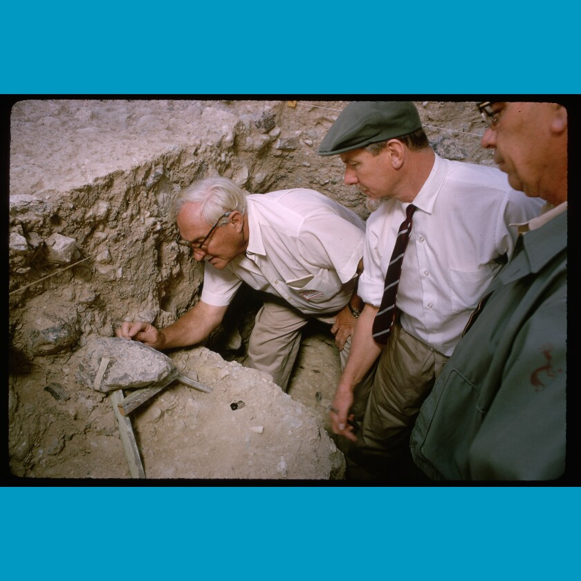 Scientists gather around Dr. Louis Leakey to see artifacts in California's Calico Hills in 1966.