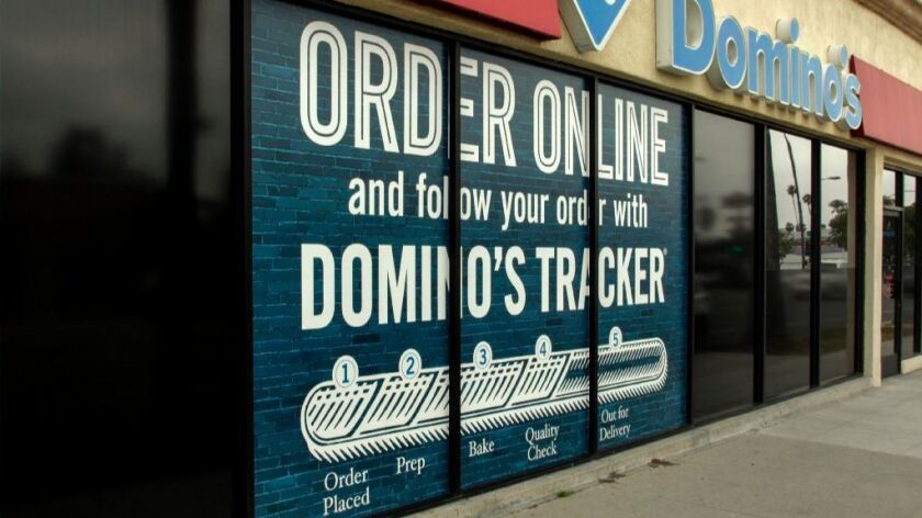 Domino's embrace of technology has helped fuel sales growth.