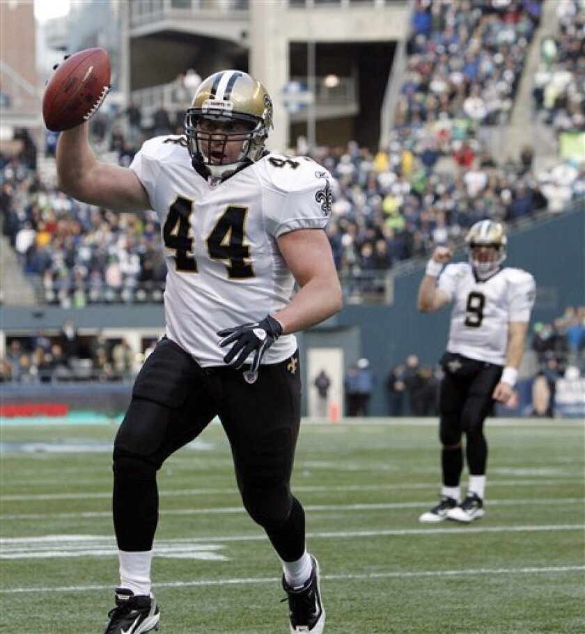 New Orleans Saints' Heath Evans (44) celebrates his touchdown against the Seattle Seahawks as quarterback Drew Brees (9) reacts during the first half of an NFL NFC wild card playoff football game, Saturday, Jan. 8, 2011, in Seattle. (AP Photo/Elaine Thompson)