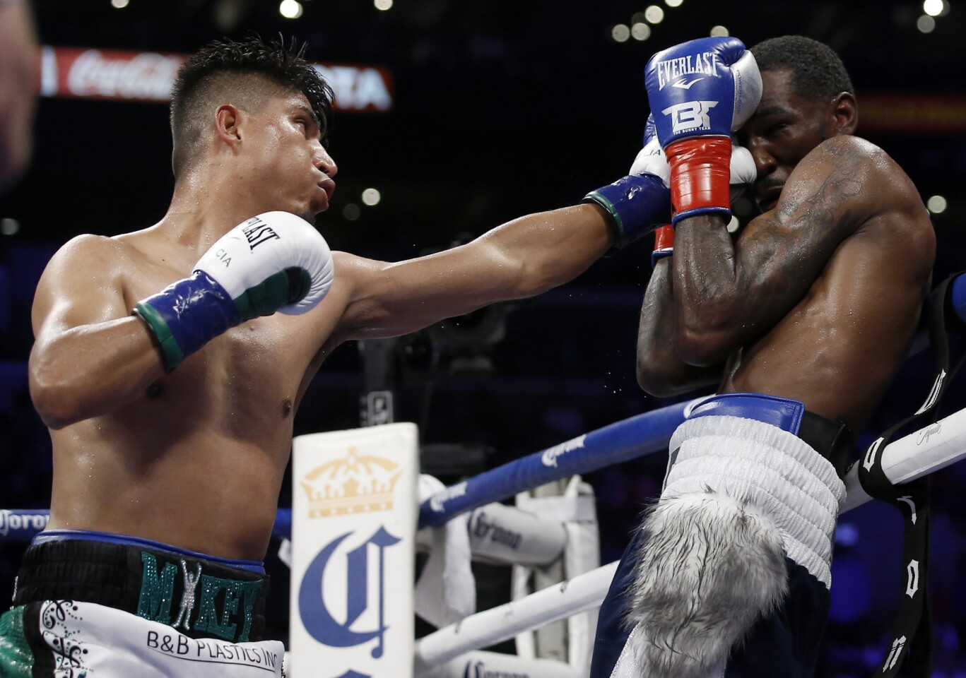 Mikey Garcia hits Robert Easter Jr. with a jab during the 11th round in their WBC and IBF world lightweight title bout in Los Angeles, Saturday, July 28, 2018. Garcia won by unanimous decision.