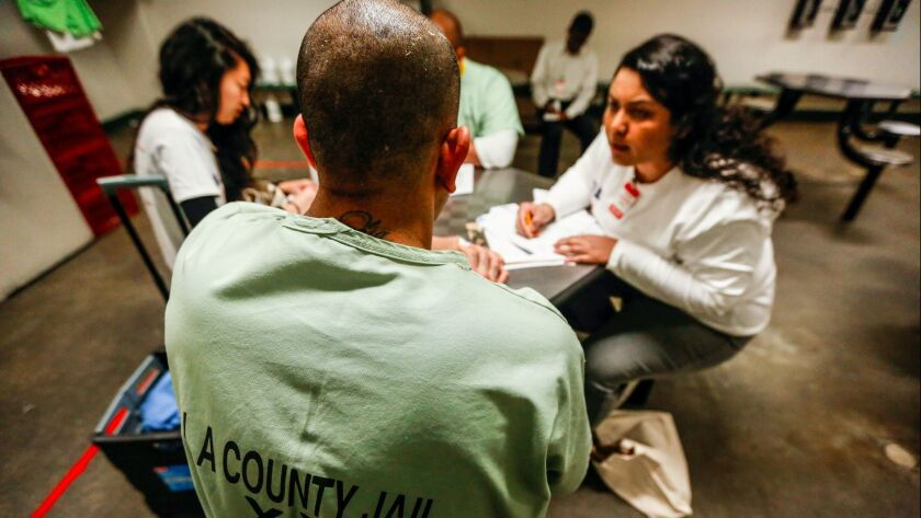 LOS ANGELES, CA--FEBRUARY 12, 2017: Elizabeth Garcias-Bynum, right, registers an inmate at the Men's