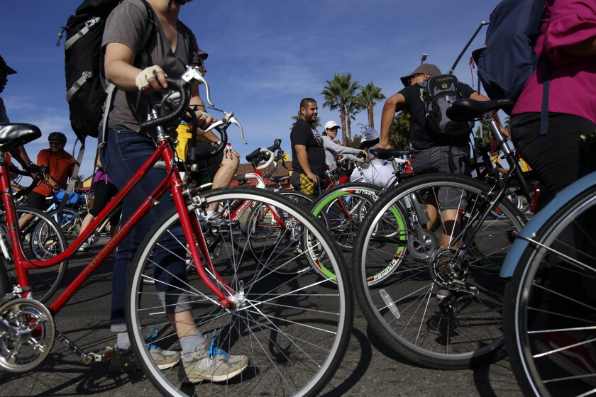 A bill in the state Legislature would require adult cyclists in California to wear a bike helmet. Above, cyclists attend CicLAvia on Martin Luther King Boulevard on Dec. 7, 2014.