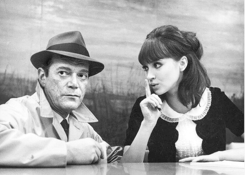 "Eddie Constantine and Anna Karina in the 1965 movie ""Alphaville."""
