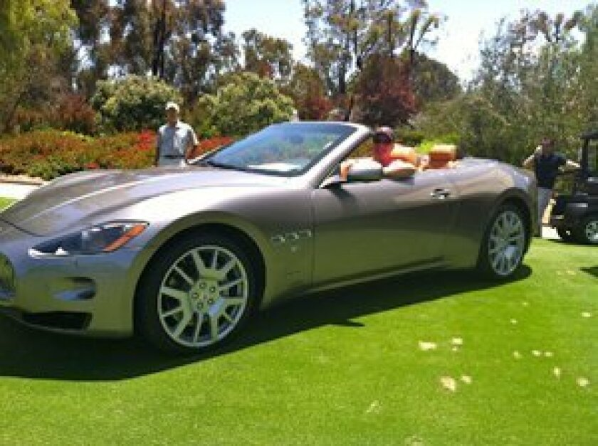 Barry Robbins with his new 2012 Maserati GranTurismo convertible.