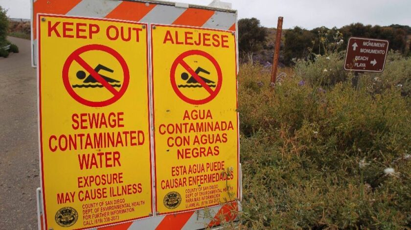 Warning signs posted at Border Field State Park at the U.S.-Mexican border in San Diego.