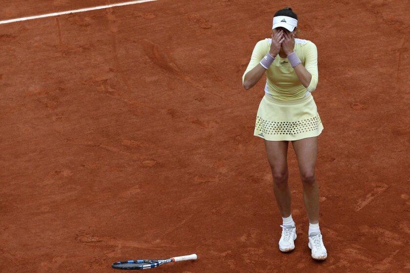 Spain's Garbine Muguruza reacts as she defeats Serena Williams of the U.S.  during their final match of the French Open tennis tournament at the Roland Garros stadium, Saturday, June 4, 2016 in Paris.  Muguruza won 7-5, 6-4. (AP Photo/Christophe Ena)