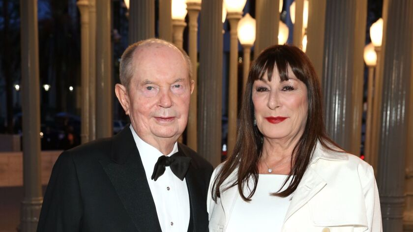 Jerry Perenchio (L) and actress Anjelica Huston attend the LACMA 50th Anniversary Gala in 2015.