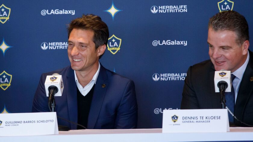 New Los Angeles Galaxy soccer head coach Guillermo Barros Schelotto answers questions with new general manager Dennis te Kloese during a news conference at the Dignity Health Sports Park in Carson.
