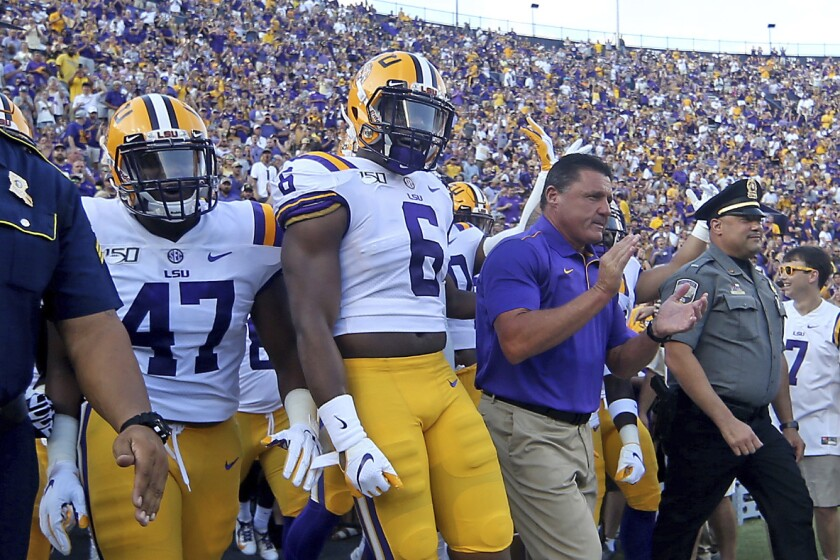 LSU head coach Ed Orgeron and the Tigers take the field during before a game against Georgia Southern in Baton Rouge, La. on Saturday.