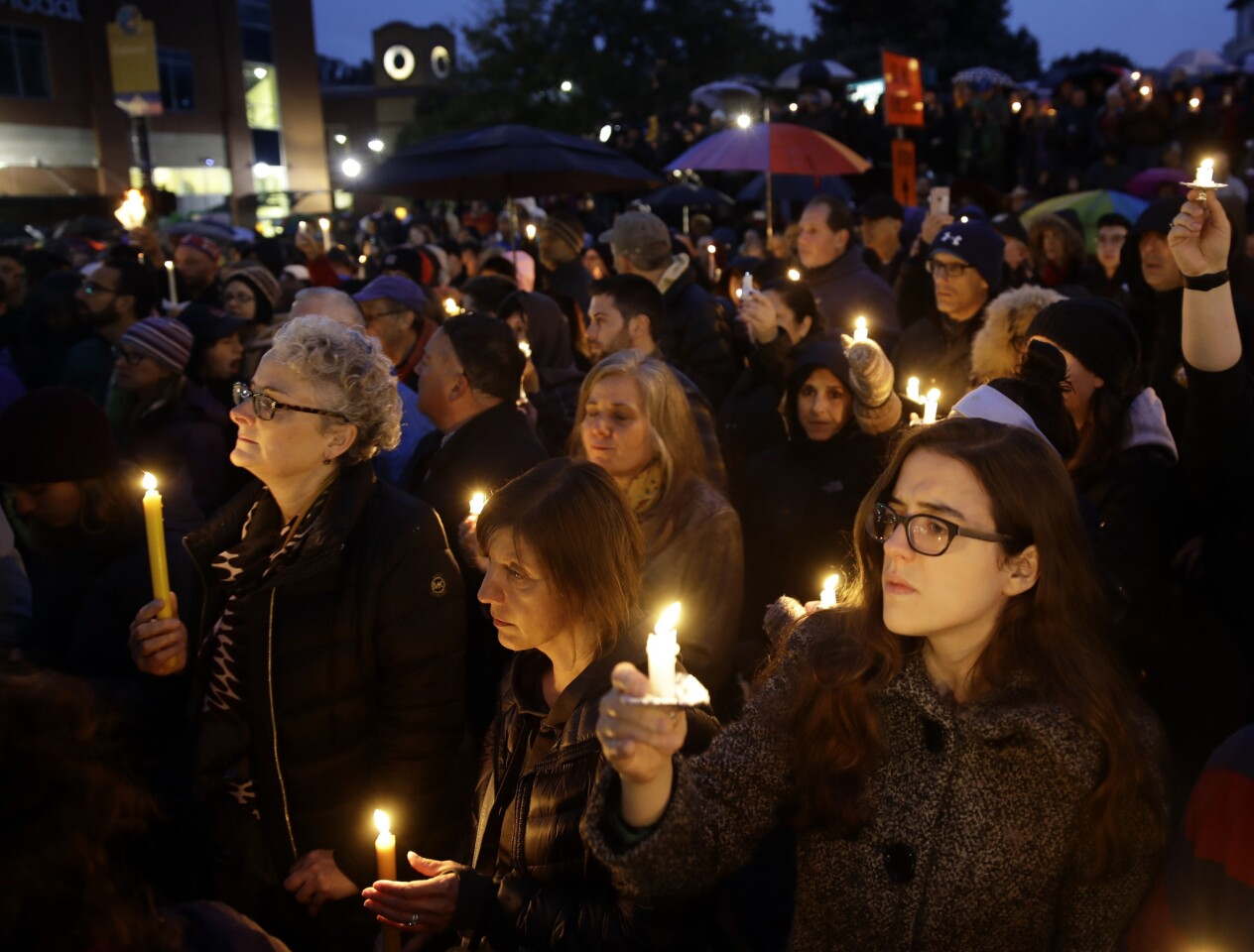 People hold candles as they gather for a vigil in the aftermath of a deadly shooting at the Tree of Life synangogue in the Squirrel Hill neighborhood of Pittsburgh on Oct. 27, 2018.