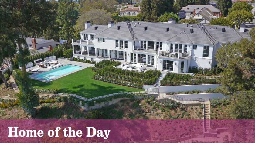 The restored East Coast Traditional rests on more than an acre in Pacific Palisades.