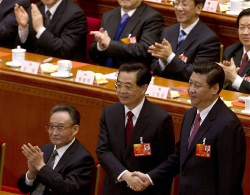 Outgoing Chinese President Hu Jintao, center, poses with his successor Xi Jinping, right, after Xi was elected at a plenary session of the National People's Congress held at the Great Hall of the People in Beijing Thursday, March 14, 2013. (AP Photo/Ng Han Guan)