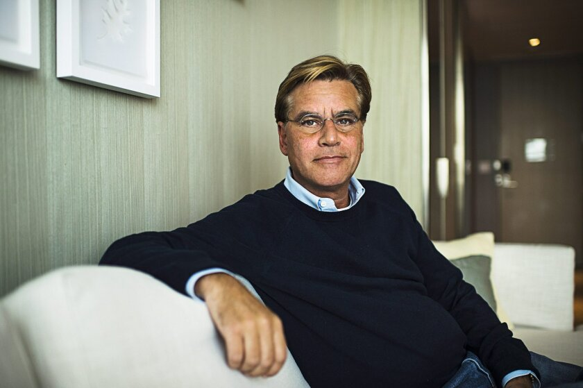 "FILE - In this Oct. 20, 2015 file photo, screenwriter Aaron Sorkin poses for a photo while promoting his movie ""Steve Jobs,"" in Toronto. Harper Lee's classic novel ""To Kill a Mockingbird"" - and it's classic hero Atticus Finch - are heading to Broadway in a new adaptation written by Sorkin. Producer"