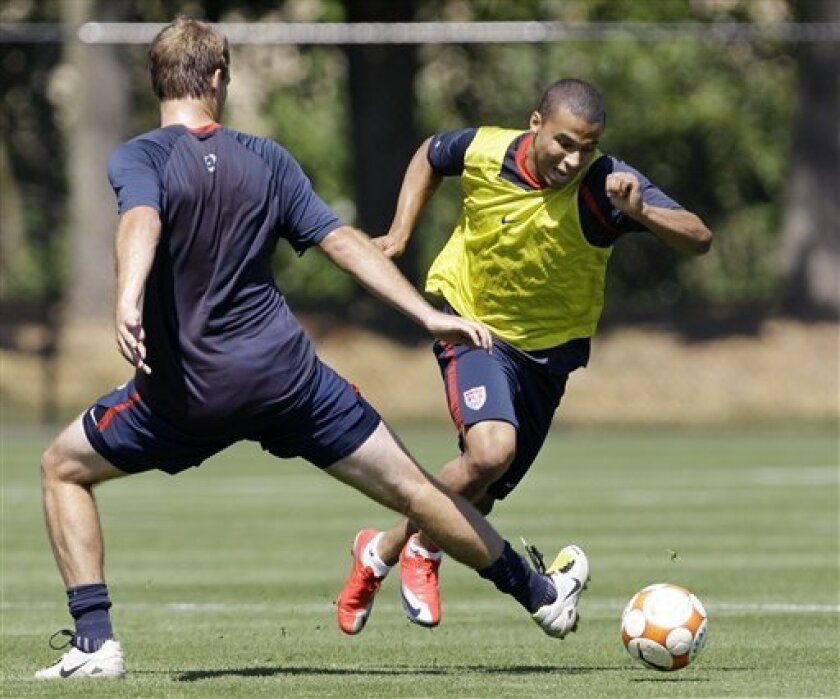 United States national team player Charlie Davies, right, races past a teammate during a practice Wednesday, July 1, 2009, in Tukwila, Wash. Three days after its stunning success in the Confederations Cup in South Africa, the American team returned home to prepare for Saturday's Gold Cup opener against Grenada in Seattle. (AP Photo/Elaine Thompson)