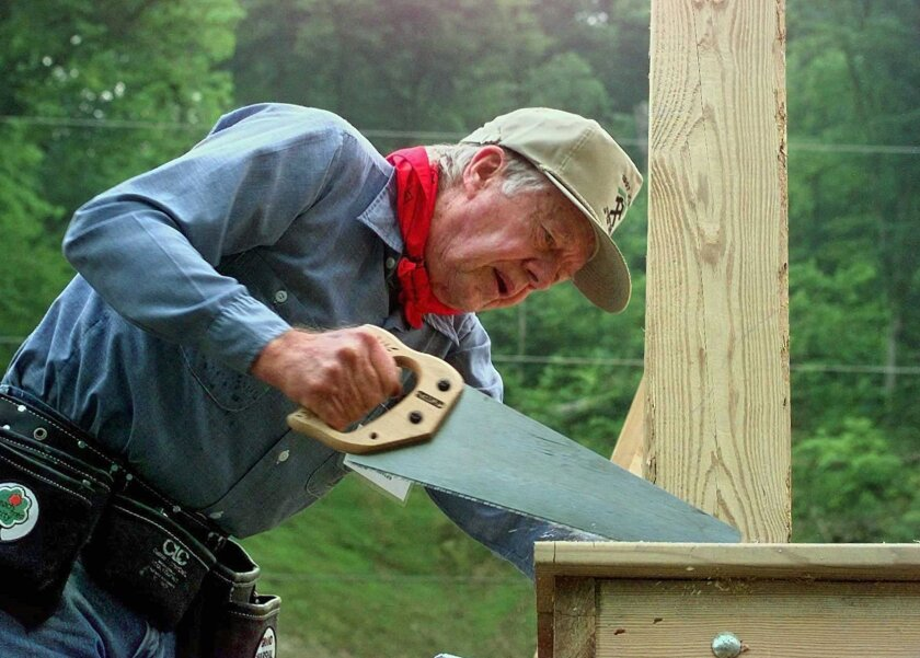 Former President Carter works on a Habitat for Humanity home in Pikeville, Ky., 1997. On Wednesday, Carter announced he has cancer and will undergo treatment at an Atlanta hospital.