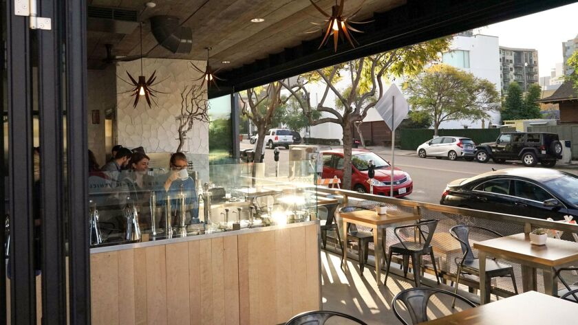 The Lofty Coffee Co. cafe took over the former parking lot to include an outdoor dining space.