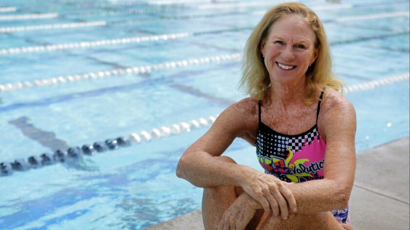 Triathlete Julie Moss, 59, of Cardiff prepares for a swim training workout at the Alga Norte Aquatic Center in Carlsbad.