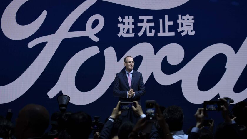 Peter Fleet, president and CEO of Ford China, speaks during an April 2018 launch event at the Beijing auto show.