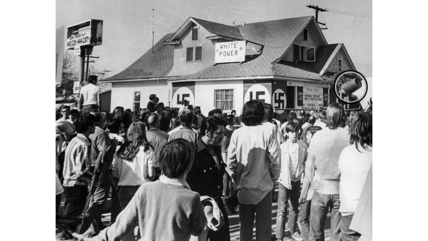Jan. 30, 1972: Anti-Nazi protesters gather outside the National Socialist White People's Party headquarters in El Monte. During the protest, eggs, bottles and a wastebasket, shown circled in the above photograph, were thrown.