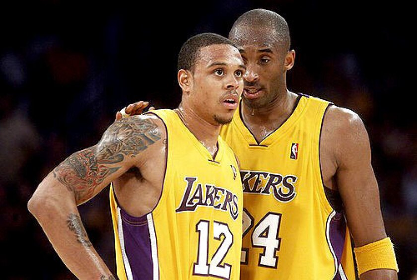 Lakers guard Shannon Brown is shown at left with Kobe Bryant.