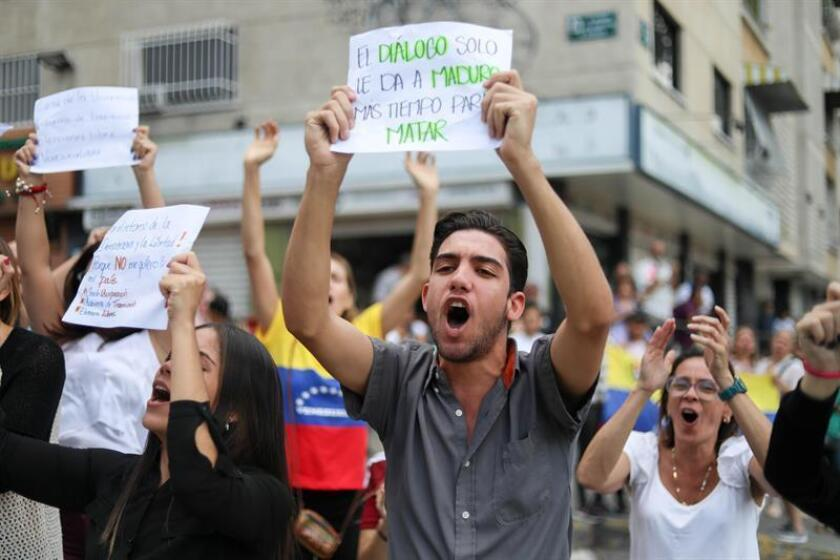 Opposition supporters demonstrate in Caracas on Jan. 30, 2019, to demand an end to the country's crisis and to support interim President Juan Guaido, the president of the Venezuelan Parliament. EFE-EPA/Cristian Hernandez