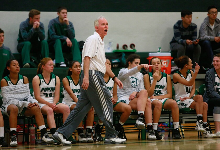 Poway girls basketball coach Jay Trousdale instructs his team from the sidelines against Mt. Carmel Tuesday.