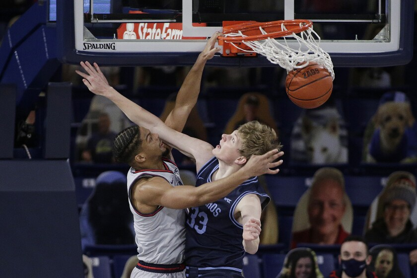 Gonzaga guard Aaron Cook dunks over San Diego forward Ben Pyle during the second half.