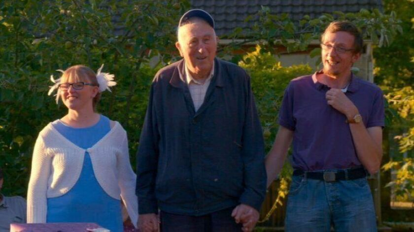 "Celine Innocent, left, Jean Vanier and Fred Dethouy in a scene from ""Summer in the Forest."""