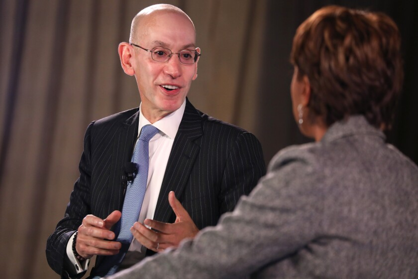 NBA Commissioner Adam Silver, left, speaks to host Robin Roberts during the Time 100 Health Summit in New York on Thursday.