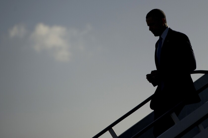 President Obama disembarks from Air Force One upon arrival at Amsterdam Schiphol International Airport as he begins a week-long trip to the Netherlands, Belgium, Italy and Saudi Arabia.