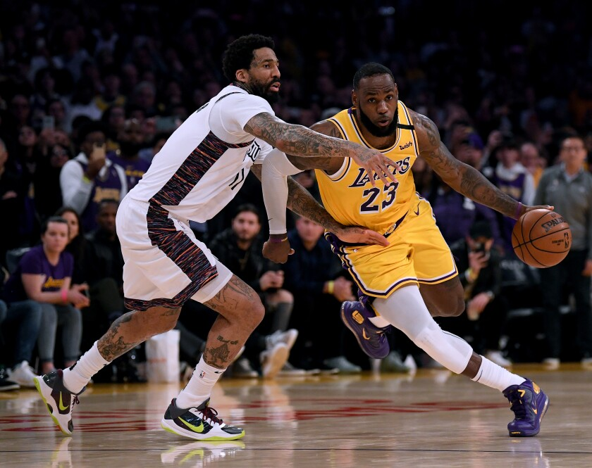 Lakers' LeBron James drives to the basket past Brooklyn Nets' Wilson Chandler during a 104-102 Nets win at Staples Center on March 10.