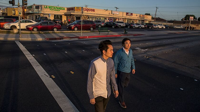 Justin Chon and his father, Sang Chon, cross Van Ness Avenue, one of the sites where Justin filmed t