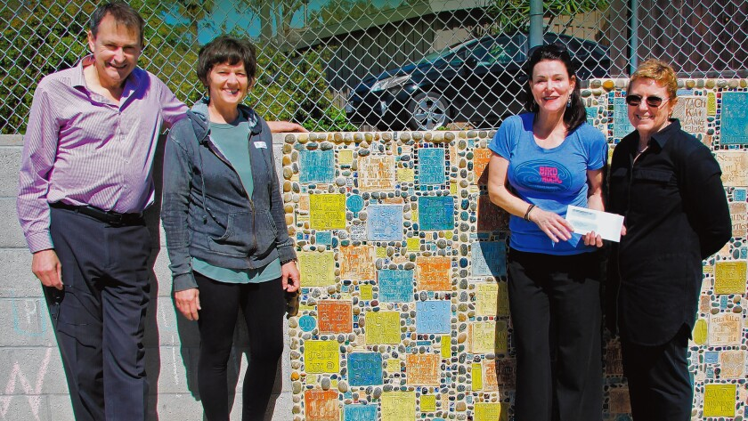 Bird Rock Community Council president John Newsam, artist Jane Wheeler, Bird Rock Elementary principal Andi Frost and BRCC Beautification Committee chair Barbara Dunbar celebrate completion of another addition to the Waverly Gate Community Wall and a donation to the school.