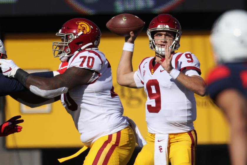 USC quarterback Kedon Slovis throws a pass against Arizona on Nov. 14, 2020, in Tucson