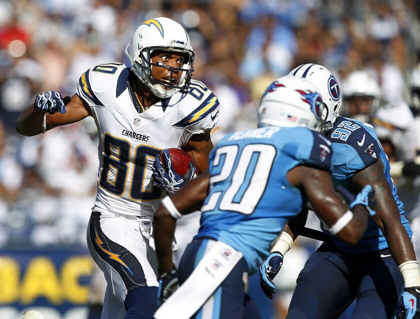 Chargers' Malcom Floyd runs after a catch in the fourth quarter against Tennessee. K.C. Alfred • U-T