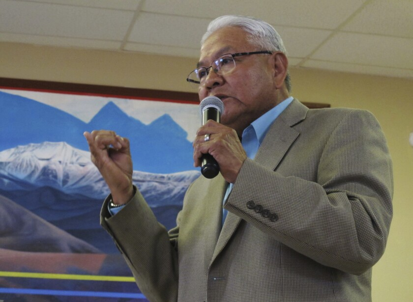 FILE - In this March 1, 2016 file photo Tommy Lewis, director of the Navajo Department of Dine Education, speaks at a public meeting, in Leupp, Ariz. Lewis, whose career spans decades in tribal communities and northern Arizona resigned from his latest post in Coconino County after officials discovered pornographic material on his work-issued computer, according to records obtained by The Associated Press. (AP Photo/Felicia Fonseca, File)