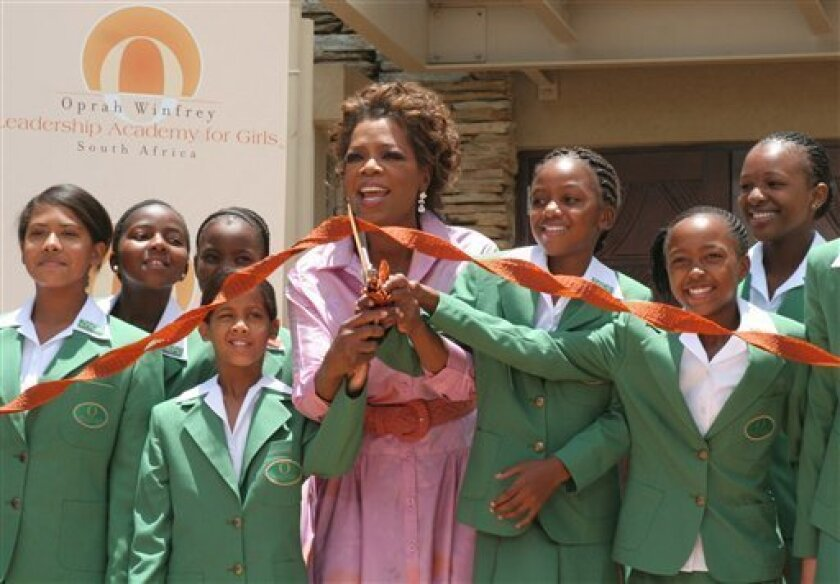 "File - U.S. talk show host Oprah Winfrey, center, with learners, during an opening ceremony of her Leadership Academy for Girls School at Henley-on-Klip, South Africa, in this Tuesday, Jan. 2, 2007 file photo. A woman accused of abusing teenagers at Oprah Winfrey's school for girls in South Africa was acquitted of the charges Monday, and Winfrey said she was ""profoundly disappointed"" by the trial's outcome. Prosecutors had accused Tiny Virginia Makopo of trying to kiss and fondle girls at the school soon after it opened in 2007 outside Johannesburg. Mthunzi Mhaga, a spokesman for South Africa's National Prosecuting Authority, said Monday Oct. 11, 2010 that Makopo had been acquitted of the charges. (AP Photo / Denis Farrell)"