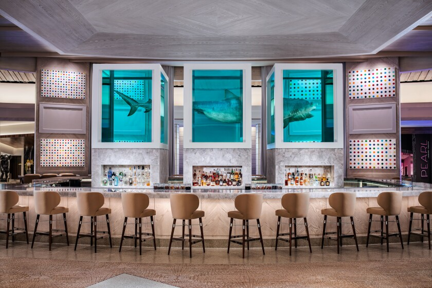 Damien Hirst's audacious sculpture of an 13-foot tiger shark preserved in three tanks floats atop the The Palms' Unkown Bar and also inspired the name of Bobby Flay's new restaurant.