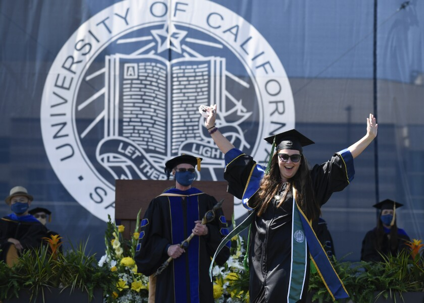 UC San Diego graduate Lisa Nicole Flores Chandler celebrates onstage during the Muir College commencement ceremony June 12.