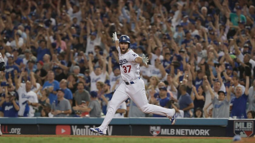 Dodgers left fielder Charlie Culberson celebrates as he circles the bases after hitting a home run in the 11th inning to cut the Dodgers' deficit to 7-6.