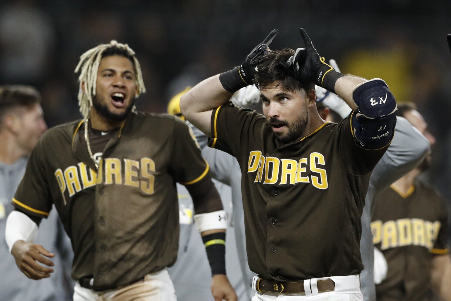 Padres looking for more offense from catchers, whoever they end up being