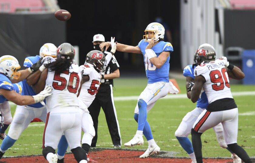 Chargers quarterback Justin Herbert (10) throws a pass against the Tampa Bay Buccaneers.