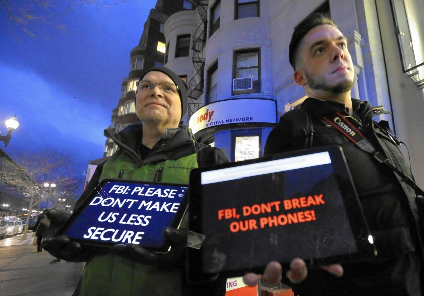 Attorneys for Apple say they plan to insist that the government explain how investigators bypassed an iPhone 5c's security. Above, demonstrators in Boston last month.