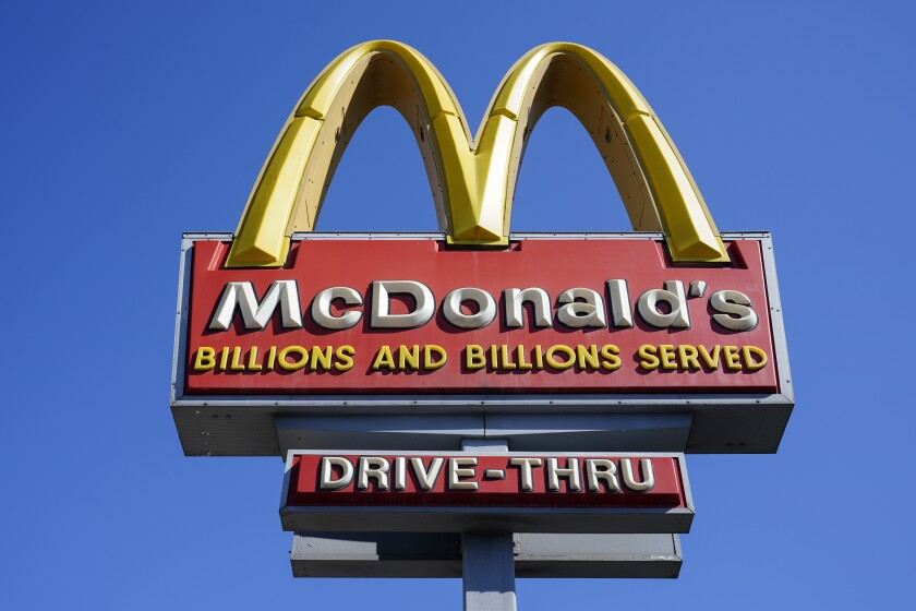 A McDonald's sign is shown in Philadelphia, Monday, April 26, 2021. McDonald's posted better-than-expected sales in the second quarter as dining rooms reopened and new products like the Crispy Chicken Sandwich drew customers. Revenue jumped 57% to nearly $5.9 billion in the April-June period. That beat Wall Street's forecast of $5.6 billion, according to analysts polled by FactSet. (AP Photo/Matt Rourke)