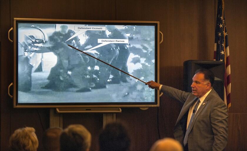 Orange County Dist. Atty. Tony Rackauckas shows the jury an image of Fullerton police trying to subdue Kelly Thomas.