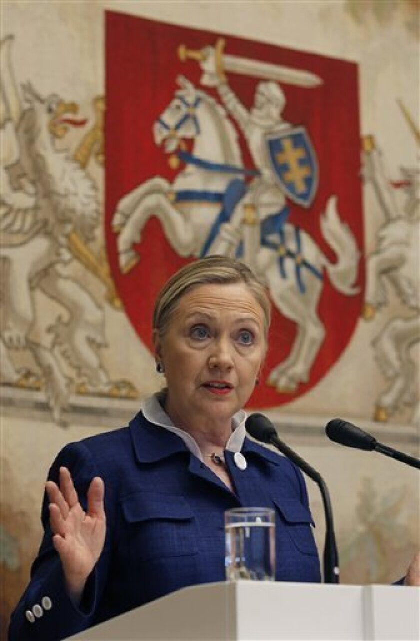 U.S. Secretary of State Hillary Rodham Clinton speaks after a meeting with President Dalia Grybauskaite of Lithuania at the Presidential Palace Friday, July 1, 2011 in Vilnius, Lithuania. Speaking Friday at an international democracy conference in Lithuania, Clinton says she is disheartened by repo