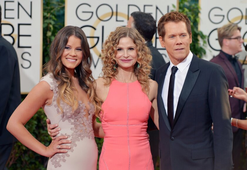 Kevin Bacon (right) and his wife, actress Kyra Sedgwick (center), pose with their daughter, Sosie Bacon, at the 2014 Golden Globe Awards at the Beverly Hilton Hotel. (Photo by John Shearer/Invision/AP)