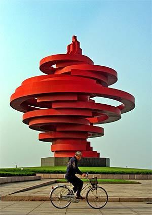 """This torch-like sculpture titled """"The Wind of May"""" is located near Fushan Bay in Qingdao, China, a popular vacation destination. The city is the beach capital of northern China, where the mainland meets the Yellow Sea. Qingdao, formerly known as Tsingtao, is also known for the beer that has been brewed in the city for more than 100 years. When the Olympics come to China this summer, the yachting events will be held in Fushan Bay."""