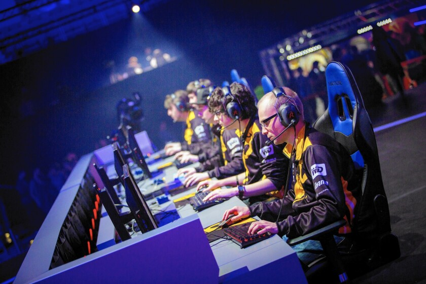 "A video-game tournament team competes in the game ""Heroes of the Storm"" at a European Championship hosted by Activision Blizzard and ESL at O2 Arena in Prague this month."